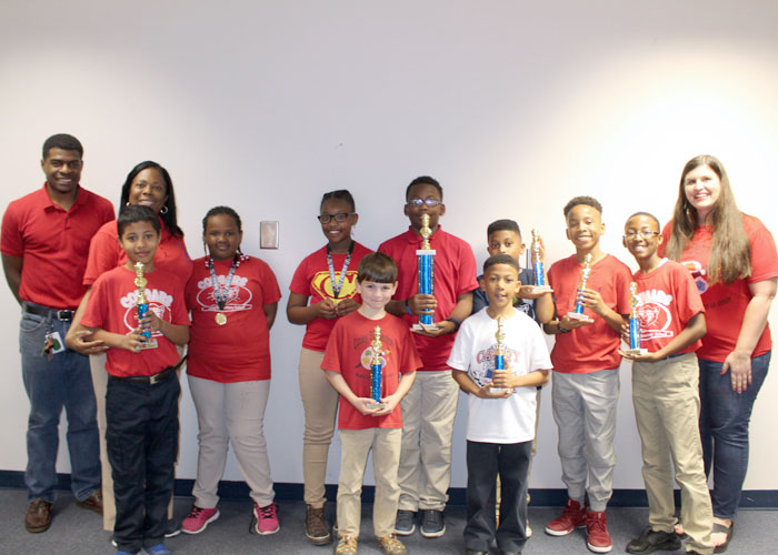 Casey chess team holding trophies