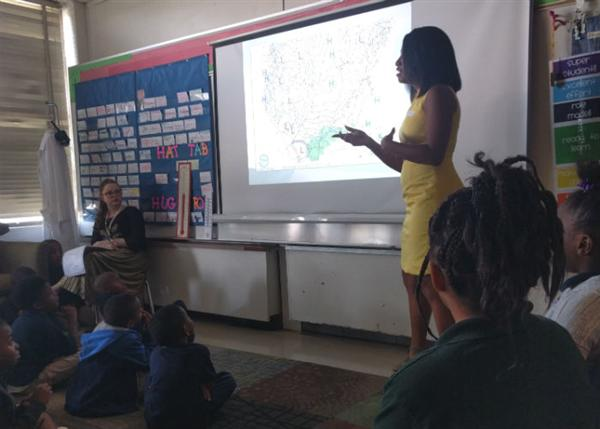 Brittany Bell teaches students at Brown about weather.