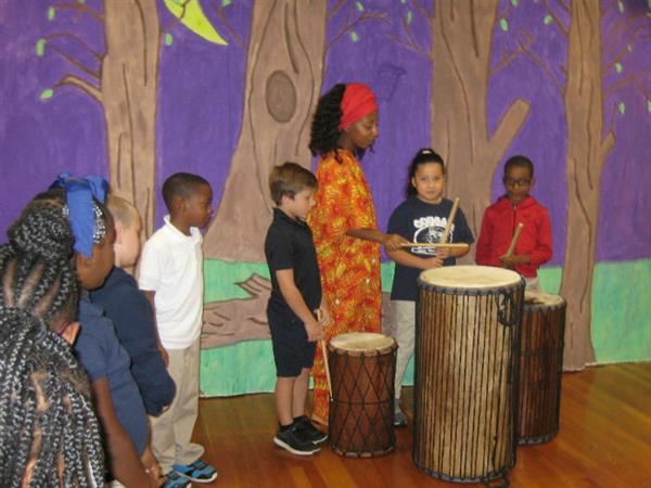 Shanina Carmichael and students on African drums