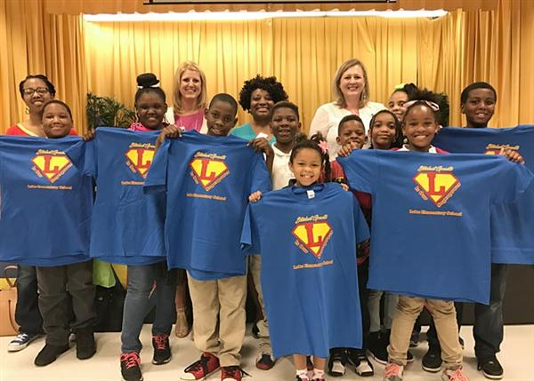 Junior League and Agape North Donate Spirit T-shirts to Lake Students