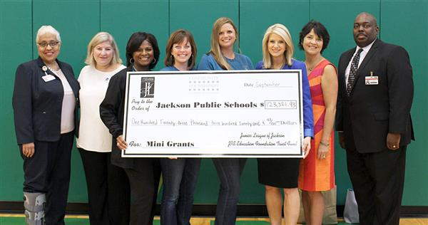 JPS administrators and Junior League with presentation check