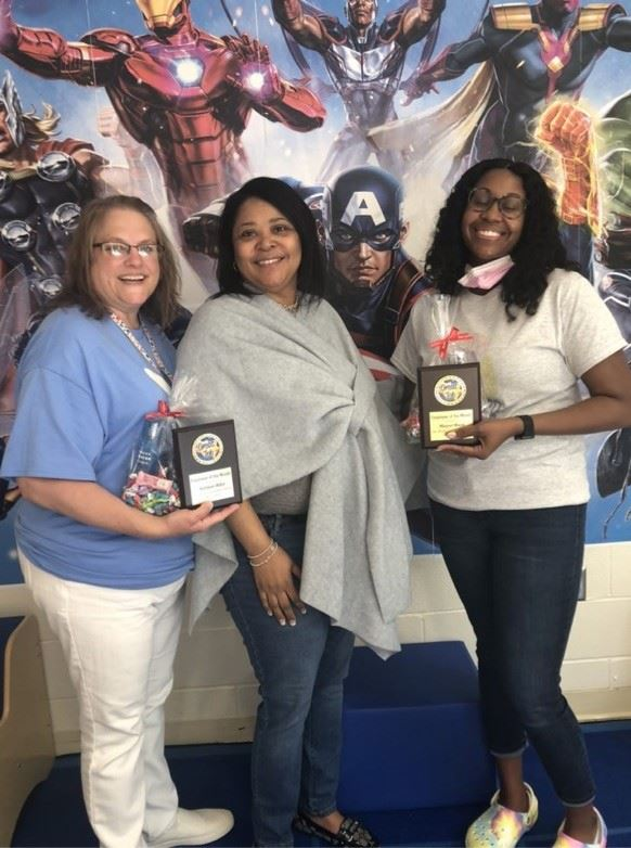 Mrs. Billiot and Ms. Moore pose with Dr. Richardson for winning Staff of the Month.