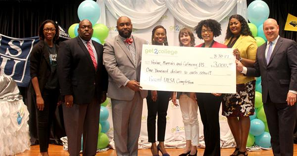Get2College and the Woodward Hines Education Foundation present a check to Callaway, Murrah, and Pr