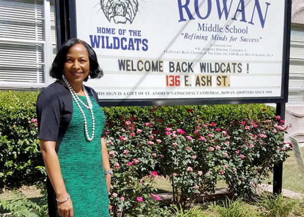 Debra McGee in front of marquee at Rowan