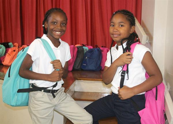 Girl scholars with their backpacks