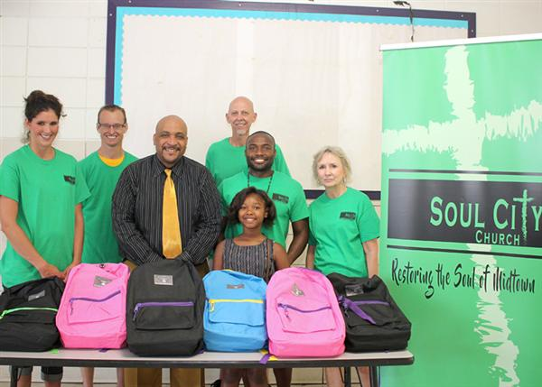 Group photo of Soul City Church members with Rowan Principal Larry Armstrong