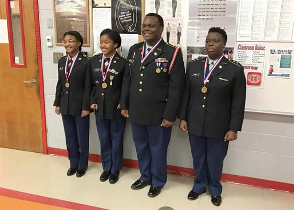 Provine JROTC STEM team cadets wearing medals and in uniform
