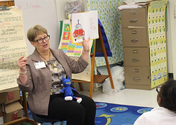 Brown Bottling representative Marilyn Williams reading to first-grade students
