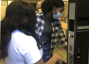 students working on vending machine