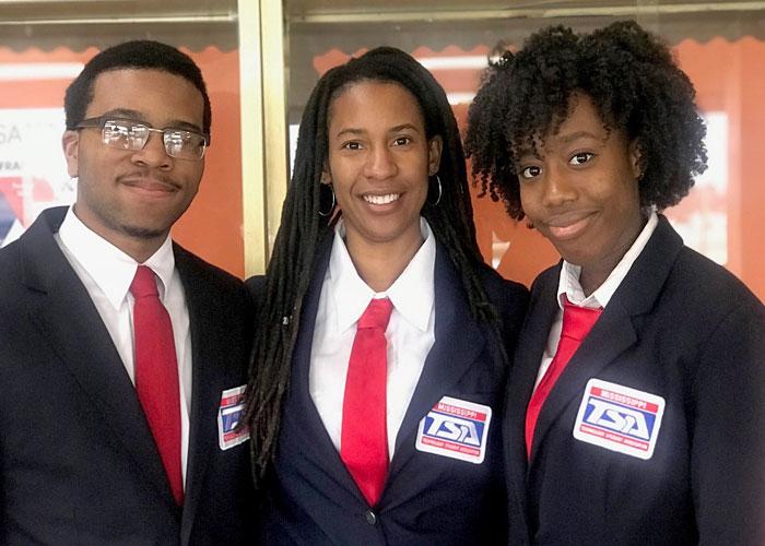 TSA members and sponsor in club jackets