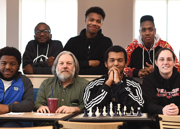 Chess Life article photo with Dave Ross, coach Beth Trasher, and Wingfield chess players