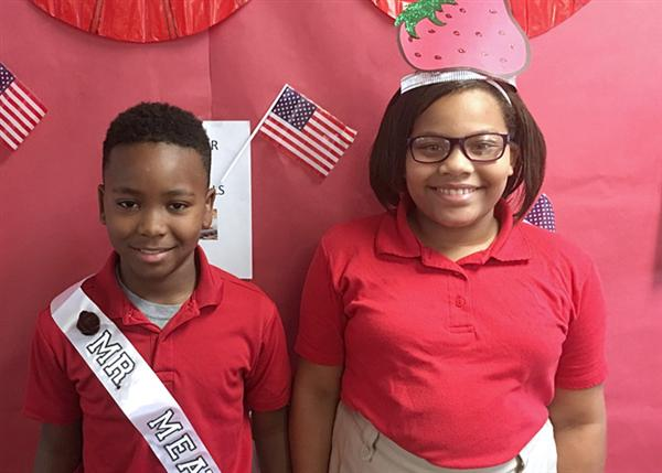 Boy wearing Mr. Meatball sash and girl wearing Ms. Strawberry crown