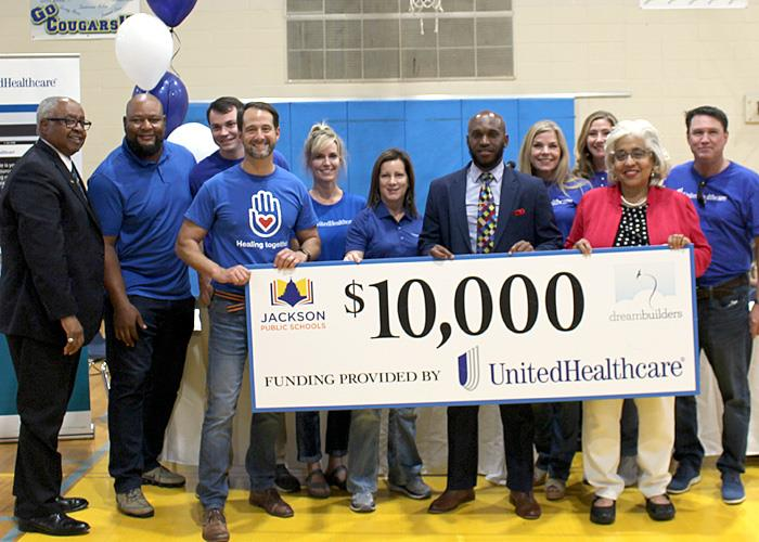 Check presentation with UnitedHealthcare, Deuce McAllister, and JPS