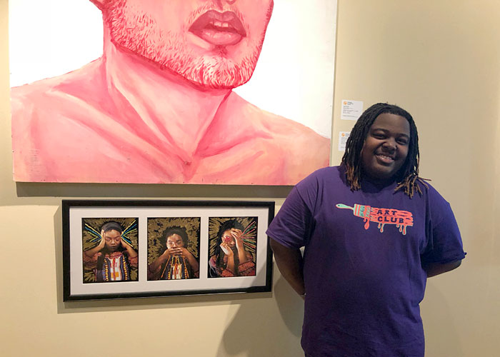 Brandon Miner and his artwork on exhibit