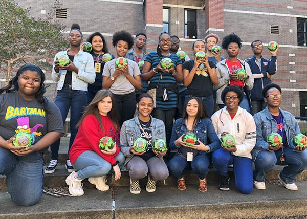 Forest Hill art students holding their ornaments