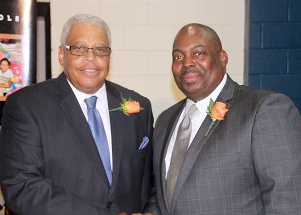 Fred Davis, retiree from Facilities and Operations, and Dr. Freddrick Murray, Interim Superintendent