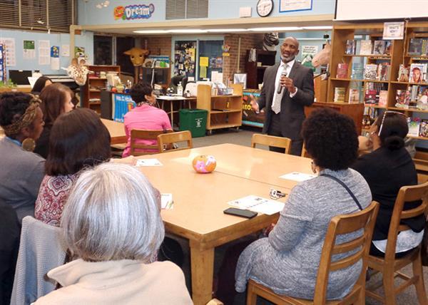 Dr. Greene speaking to teachers