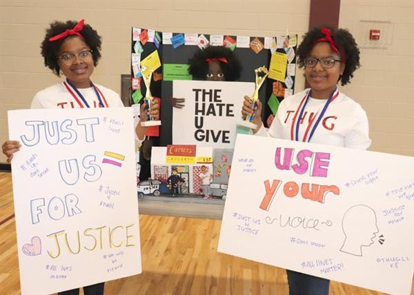Arielle Brumfield and Arianna Brumfield with Hate U Give Story Board