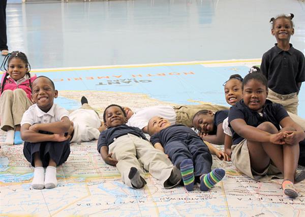 Students enjoying floor map