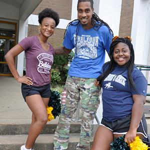 High school students smiling wearing Mississippi State and Jackson State T-shirts