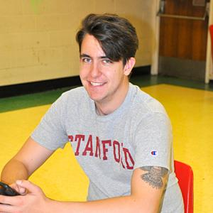 High school student smiling wearing Stanford T-shirt