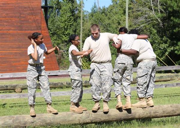 Cadets moving on log