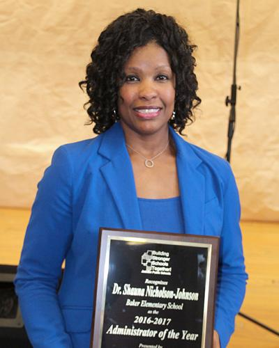Dr. Shauna Nicholson-Johnson holding Administrator of the Year plaque