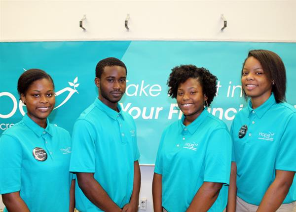 Business and Finance Academy students in their Hope Credit Union uniform shirts.