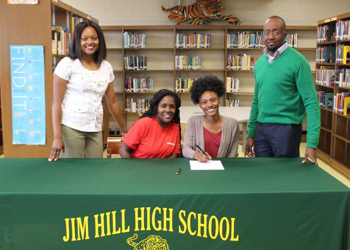 Talayla Davis with family and coach
