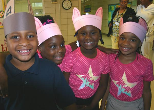 "1st graders perform their own musical version of the ""Three Little Pigs."""