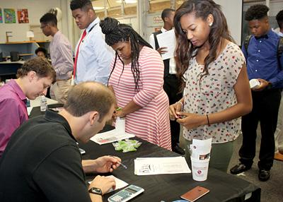 Murrah students check their spending with Regions Bank volunteers