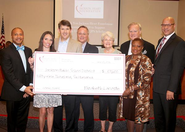 Dr. Gray and Beneta Burt accept donation from members of Jackson Heart Foundation