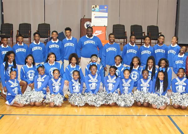 Kirksey Middle School cheerleaders and basketball team in uniform shirts