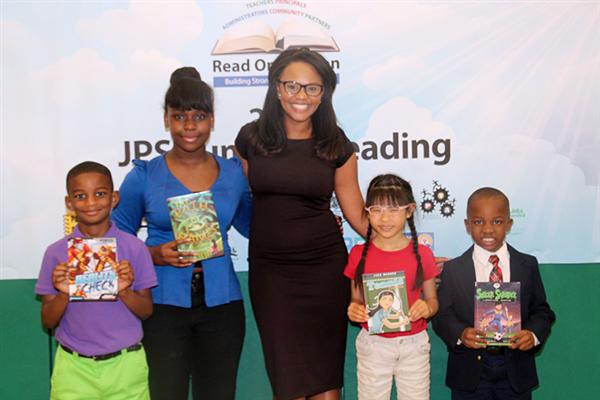Brittany Noble-Jones with four students, each holding books