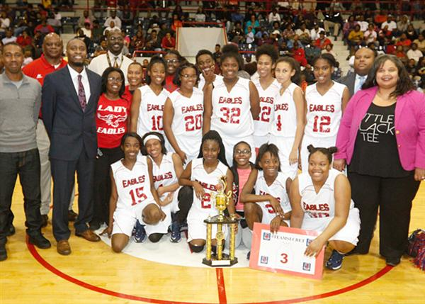 Brinkley girls basketball team with trophy surrounded by school staff and supporters