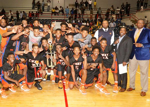 Callaway boys basketball team raising trophy