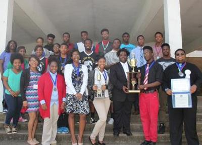Jim Hill 11th and 12th grade Science Fair winners wearing medals and displaying trophies