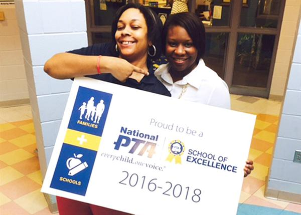 PTA members holding 2016-2018 National School of Excellence banner