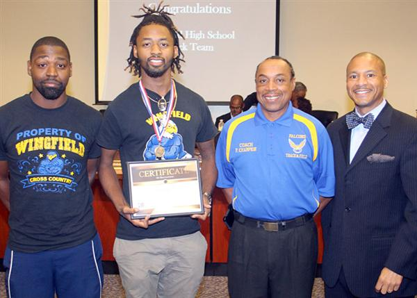 Wingfield Track Star with coaches and JPS Superintendent Dr. Gray